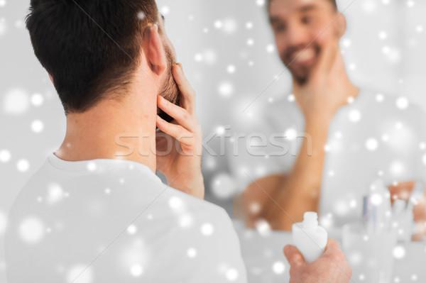 Man room gezicht badkamer Stockfoto © dolgachov