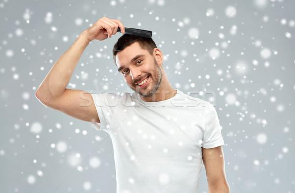 Mutlu adam saç tarak kar güzellik Stok fotoğraf © dolgachov