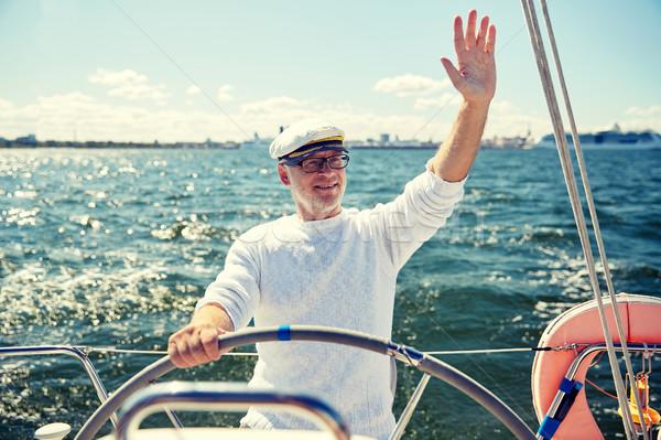 Senior homem barco iate navegação mar Foto stock © dolgachov