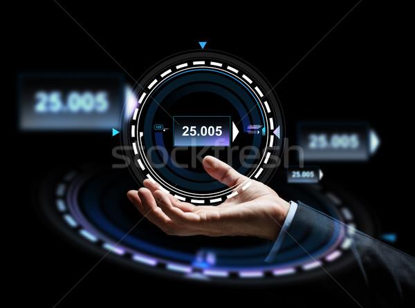 close up of businessman hand with hologram Stock photo © dolgachov