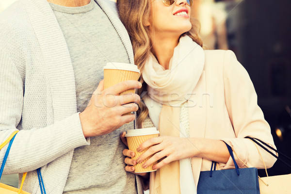 close up of couple with shopping bags and coffee Stock photo © dolgachov