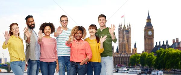 international people waving hand in london Stock photo © dolgachov