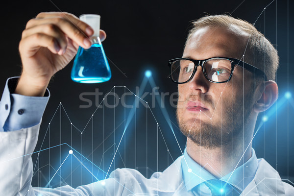young scientist holding test flask with chemical Stock photo © dolgachov