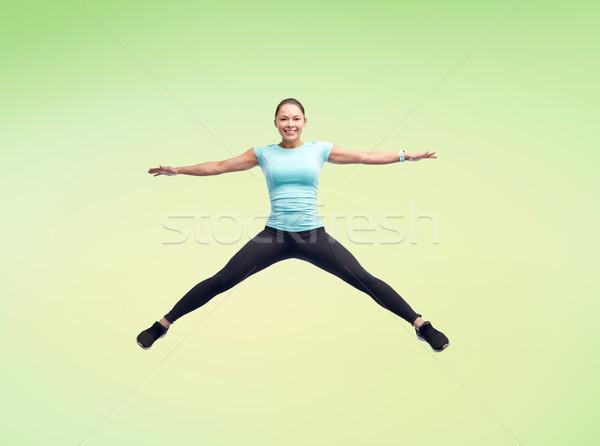 Stok fotoğraf: Mutlu · gülen · genç · kadın · atlama · hava