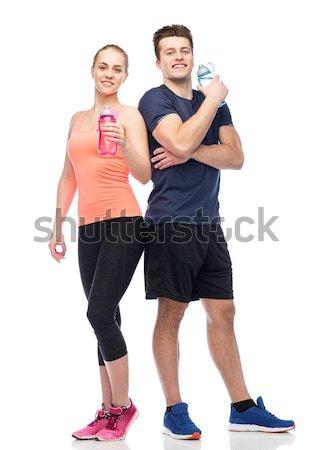 Homme femme eau bouteilles sport fitness Photo stock © dolgachov