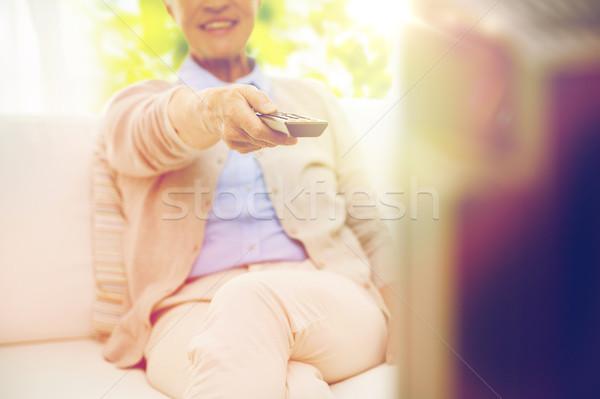 Közelkép boldog idős nő néz tv Stock fotó © dolgachov