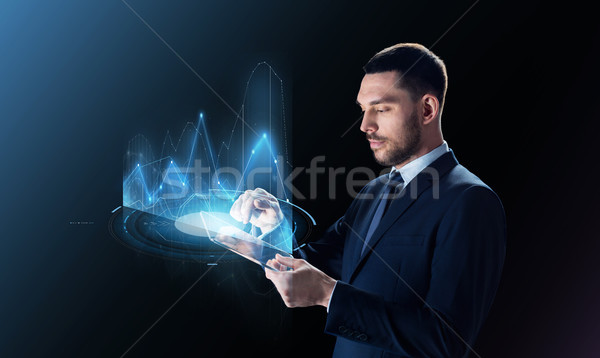 businessman with tablet pc and virtual charts Stock photo © dolgachov