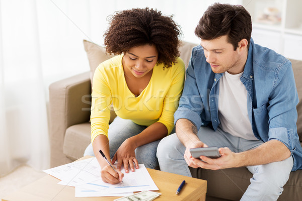 couple with papers and calculator at home Stock photo © dolgachov