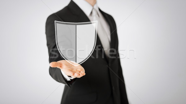 man with virtual antivirus program icon Stock photo © dolgachov