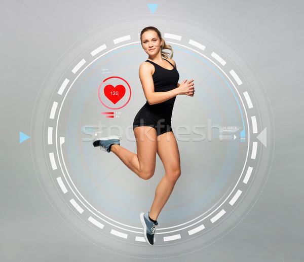 Fiatal nő fekete sportruha ugrik pulzus sport Stock fotó © dolgachov