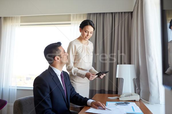 бизнес-команды документы рабочих номер в отеле деловые люди команде Сток-фото © dolgachov