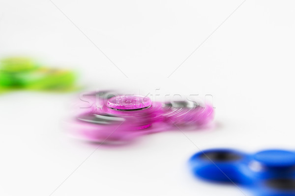 close up of spinning fidget spinners Stock photo © dolgachov