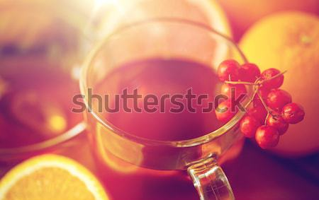tea with honey, orange and rowanberry on wood Stock photo © dolgachov