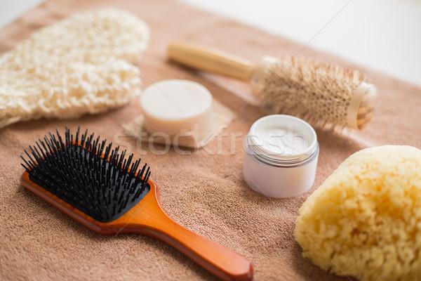 hair brush, cream, sponge, soap bar and bath towel Stock photo © dolgachov