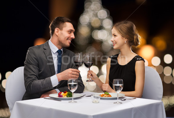 couple with non alcoholic wine at christmas Stock photo © dolgachov