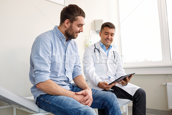 doctor with tablet pc and male patient at hospital Stock photo © dolgachov