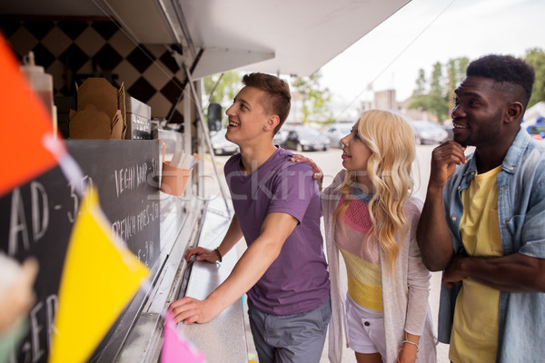 happy customers queue or friends at food truck Stock photo © dolgachov