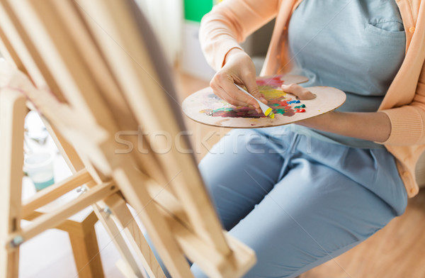 artist applying paint to palette at art studio Stock photo © dolgachov
