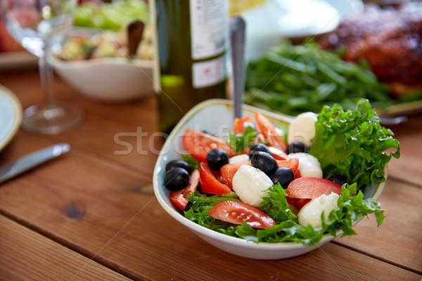 Zöldség saláta mozzarella fa asztal egészséges étkezés vegetáriánus étel Stock fotó © dolgachov