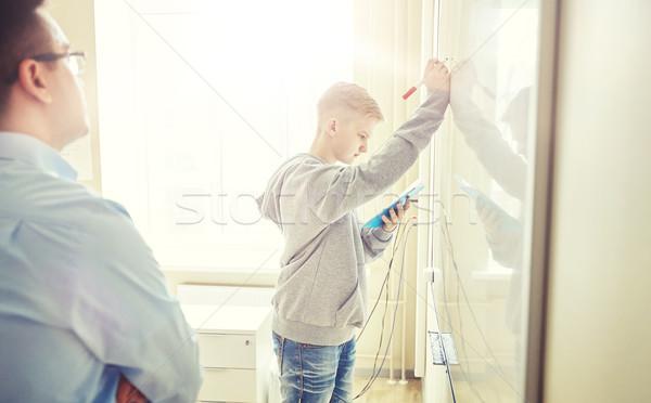 Zdjęcia stock: Nauczyciel · student · piśmie · pokładzie · szkoły · edukacji