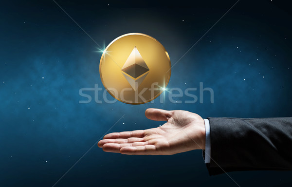 businessman hand with etherum over space Stock photo © dolgachov