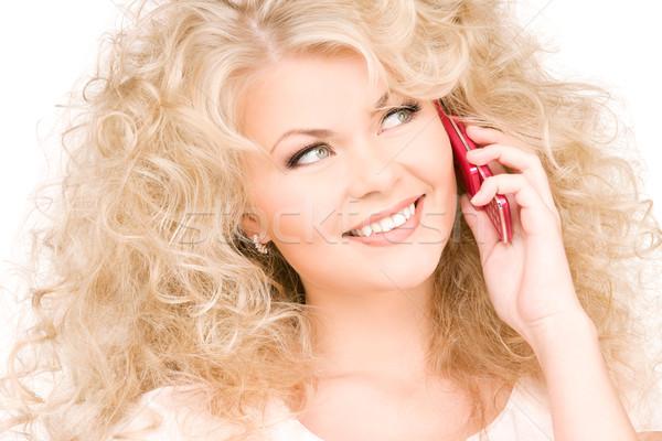 Сток-фото: счастливым · женщину · розовый · телефон · портрет · лице