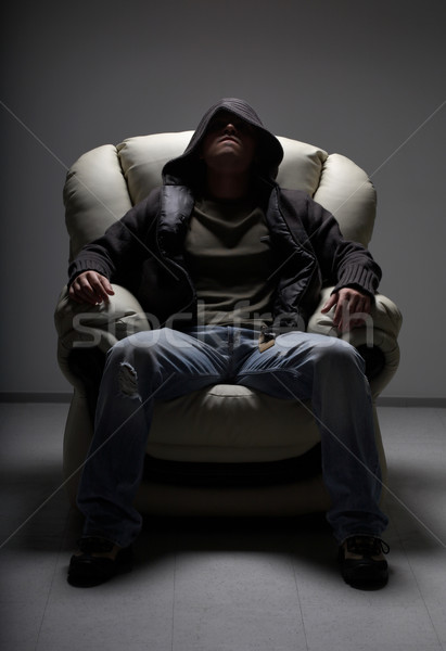 dangerous man sitting in white chair Stock photo © dolgachov