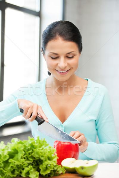 beautiful woman in the kitchen Stock photo © dolgachov