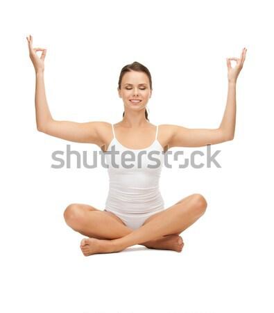 young woman doing exercises, yoga, pilates Stock photo © dolgachov