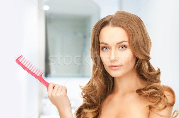 beautiful woman with comb Stock photo © dolgachov