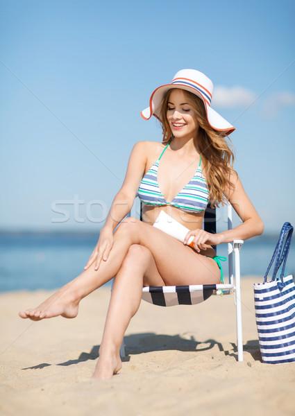 Kız güneşlenme şezlong yaz tatil tatil Stok fotoğraf © dolgachov