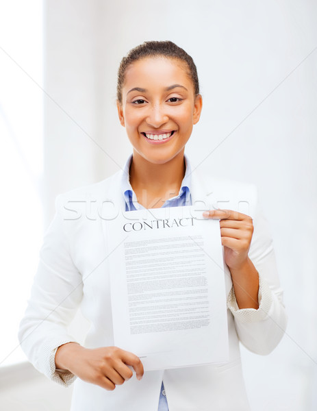 african businesswoman holding contract Stock photo © dolgachov