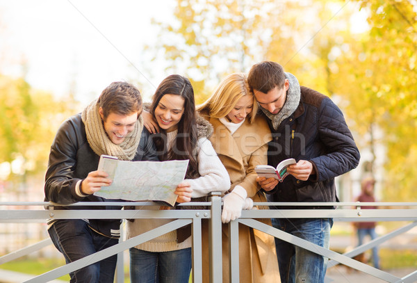 couples with tourist map in autumn park Stock photo © dolgachov