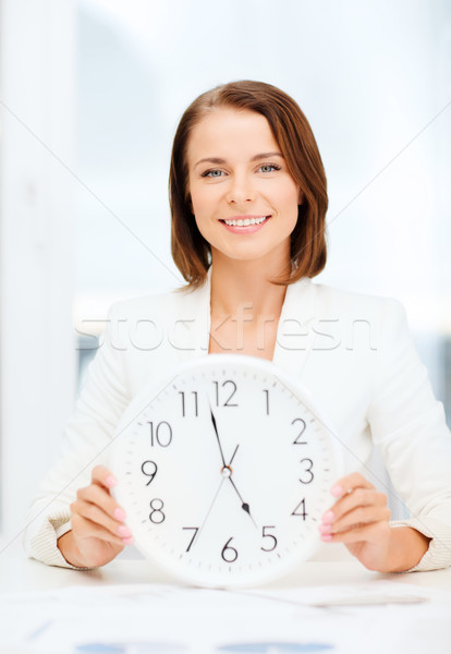attractive businesswoman with white clock Stock photo © dolgachov