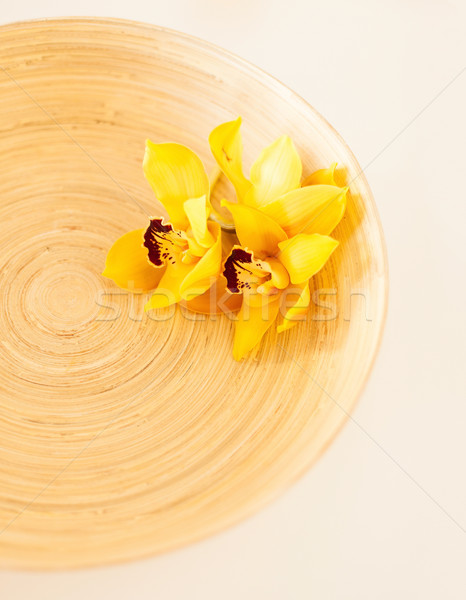 closeup of wooden bowl with orchid flowers Stock photo © dolgachov