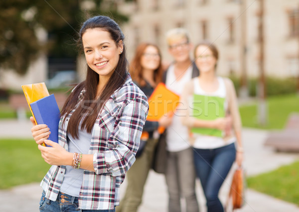 teenage girl with folders and mates on the back Stock photo © dolgachov