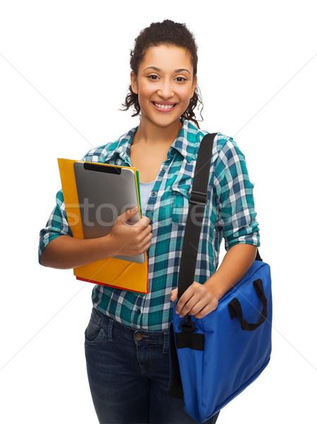Glimlachend student mappen zak onderwijs Stockfoto © dolgachov