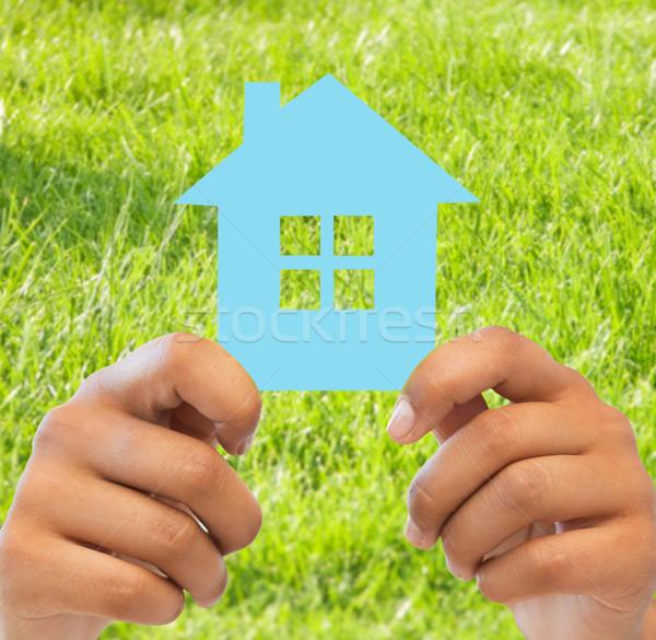 Mujer manos azul casa negocios Foto stock © dolgachov