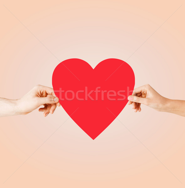 couple hands holding red heart Stock photo © dolgachov