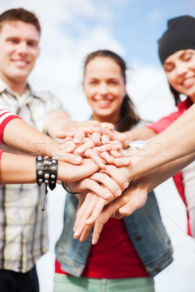 teenagers hands on top of each other outdoors Stock photo © dolgachov
