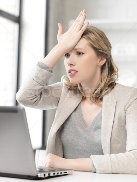 stressed woman with laptop computer Stock photo © dolgachov