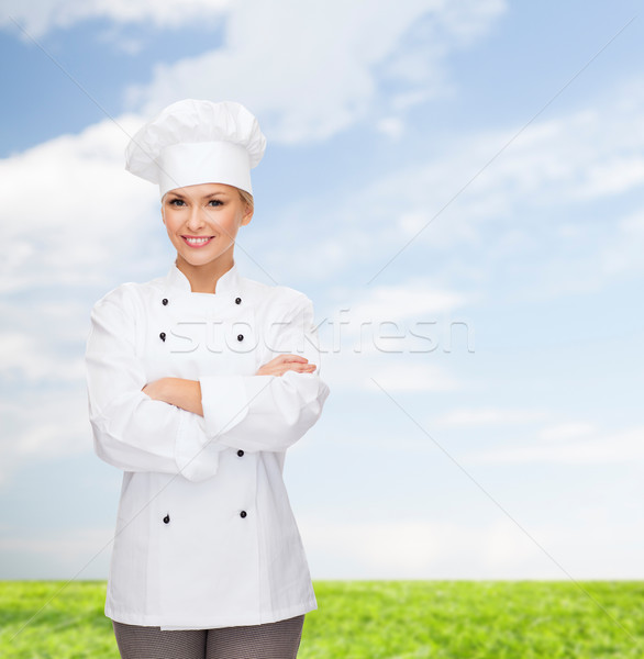 smiling female chef with crossed arms Stock photo © dolgachov