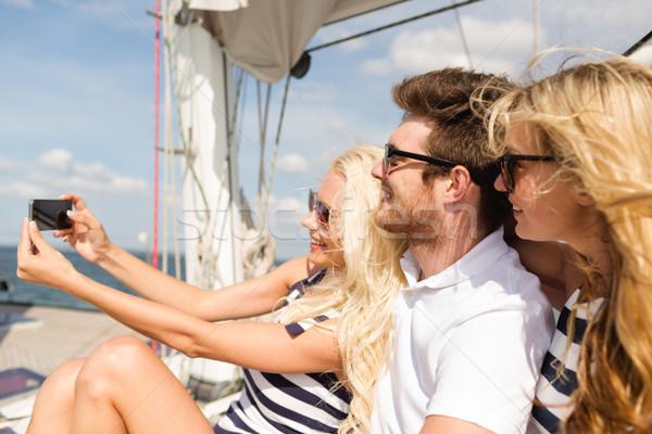 улыбаясь друзей сидят яхта палуба отпуск Сток-фото © dolgachov