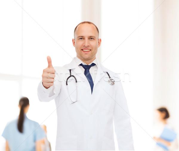 smiling male doctor with stethoscope Stock photo © dolgachov