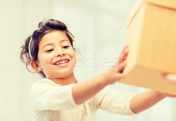 happy child girl with gift box Stock photo © dolgachov