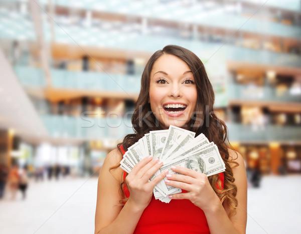 Photo stock: Femme · robe · rouge · dollar · argent · vacances · bancaires