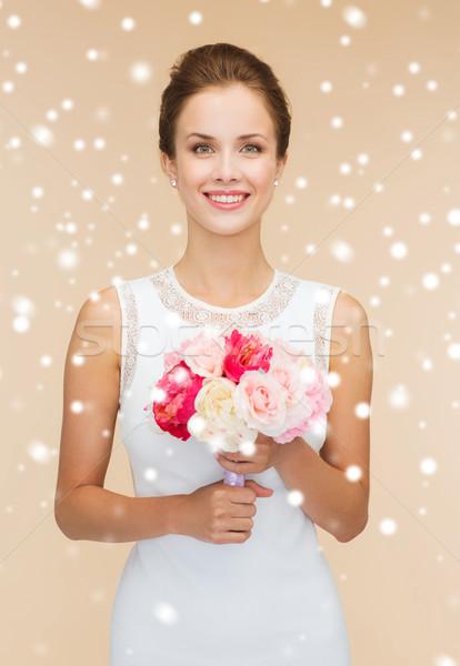 Lächelnde Frau weißen Kleid Haufen Blumen Glück Hochzeit Stock foto © dolgachov
