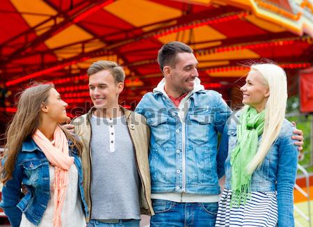 smiling couple in amusement park Stock photo © dolgachov