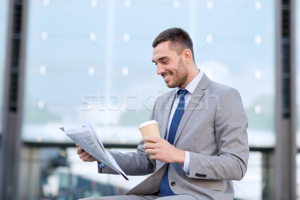 Stock photo: young businessman with coffee and newspaper