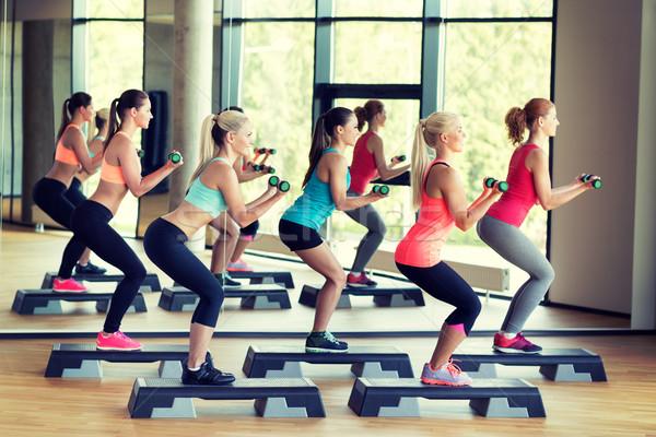 グループ 女性 ダンベル フィットネス スポーツ 訓練 ストックフォト © dolgachov